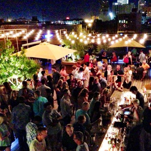 Live entertainment and a full bar keep the rooftop patio at Packard's New American Kitchen buzzing.