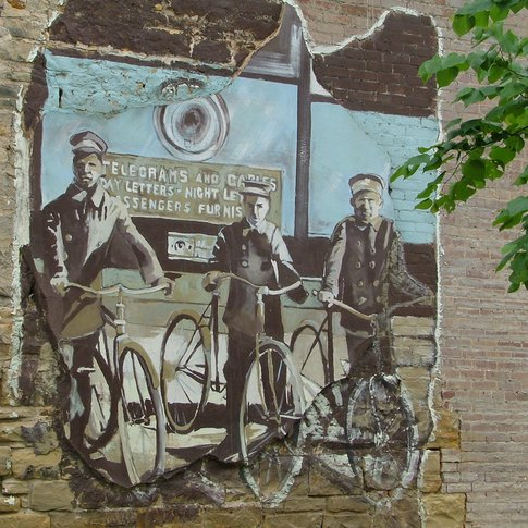 Palmer Studios added this Muskogee Postcard Mural to a local business building in 2001.