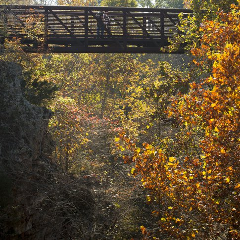Natural Falls State Park in West Siloam Springs features unexpected historical treasures like the swinging bridge with stunning views of the park.