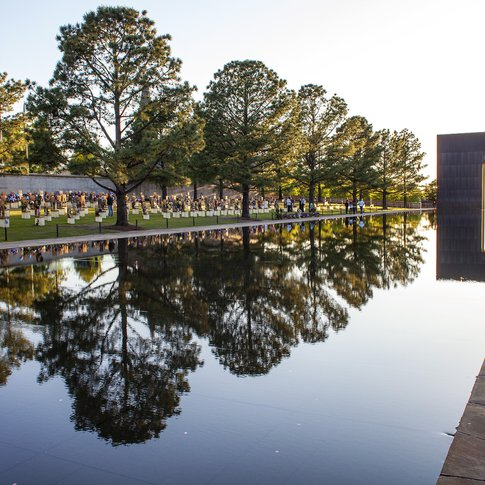 The Field of Empty Chairs honors each of the 168 people who were killed, and a 318-foot long reflecting pool fills the cooridor between the monumental bronze-clad Gates of Time.