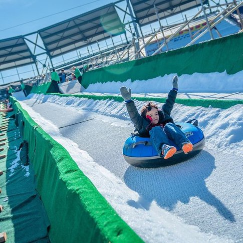 Snow tube down the nation's largest man-made slope during Oklahoma City's Downtown in December event.