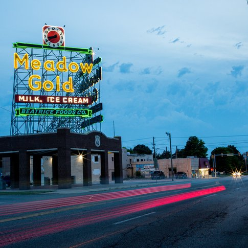 The circa-1939 Meadow Gold sign in Tulsa lights up the sky along Route 66.