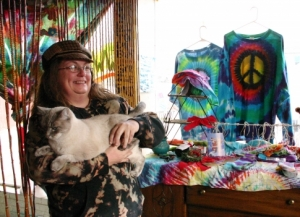 Kelly Killion, owner of Tie-Dyes of Tulsa, sells tie-dyed T-shirts, hats, skirts and socks from her shop next to Route 66.