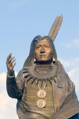 The monumental 22-ft bronze statue of Chief Standing Bear is the centerpiece of Standing Bear Park, where visitors can walk along a path with audio stations and interpretive signage about area tribes and the contributions made by the Poncan chief.