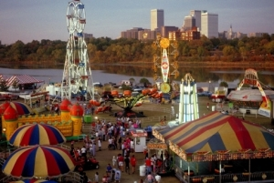 The Tulsa skyline rises in the background of the Tulsa Oktoberfest celebration.