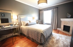 The Pearl Room within Tulsa's Campbell Hotel features an in-room fireplace and soothing gray tones.