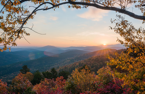 The sun setting over the Ouachita Mountains is a beautiful sight for travelers on the Talimena National Scenic Byway in southeast Oklahoma.