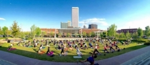 Gather outdoors in Tulsa districts for activities like yoga held on the Guthrie Green in the Tulsa Arts District.